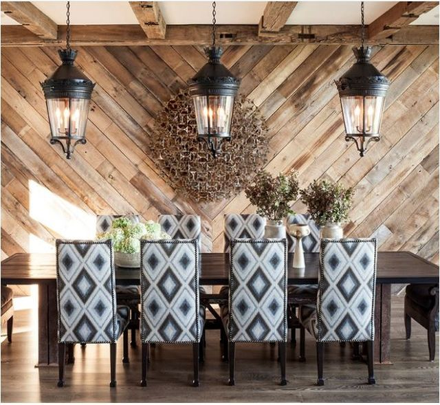 Modern lighting and art are also present in this tahoe home the diaconal plank walls add interest to the dining room and the stone fireplace and timber
