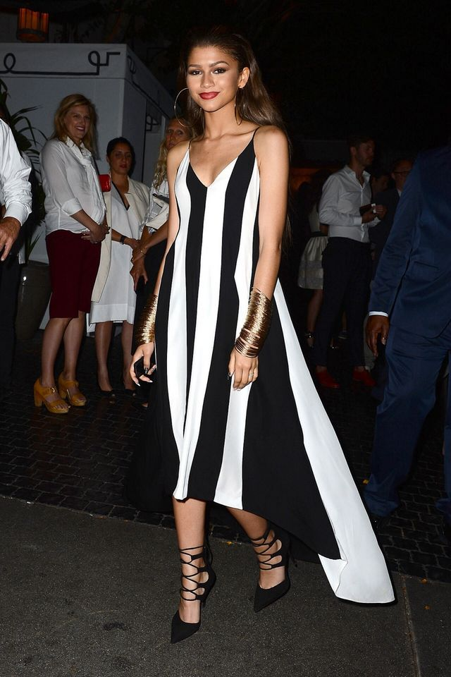 304a9a19fe33d The rising fashion star attended the MaxMara and W Magazine Cocktail Party  in a black and white striped Max Mara dress anchored by $925 Giuseppe  Zanotti ...