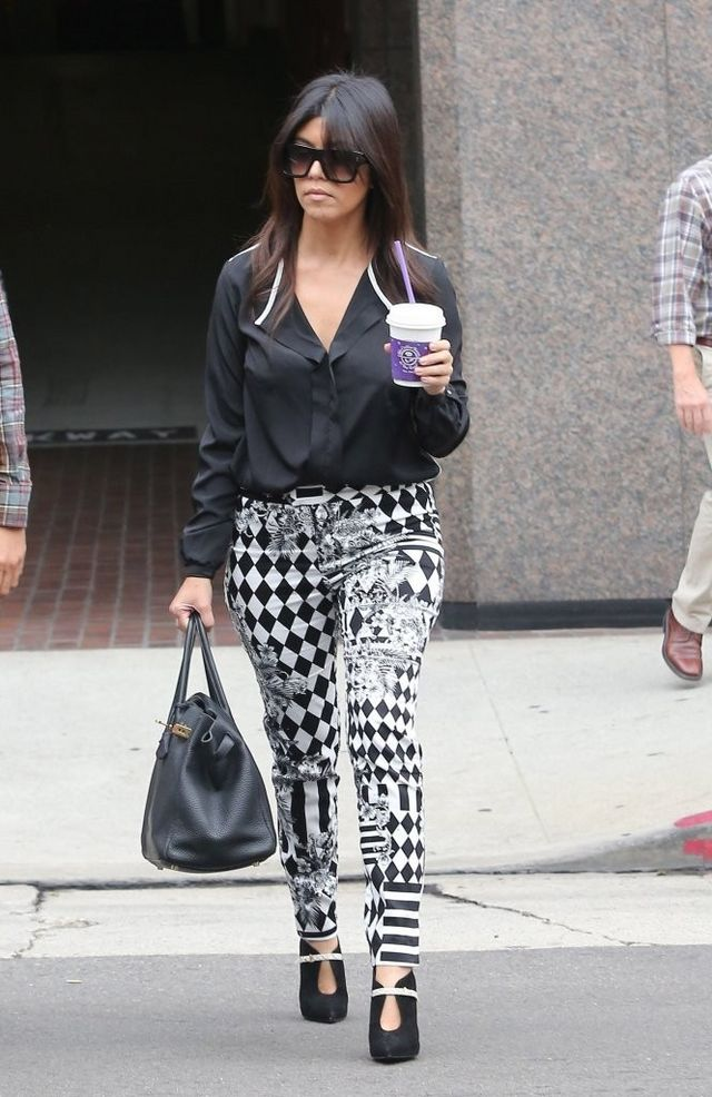 2d061c67af2f Get the Look: Kourtney Kardashian's Beverly Hills Black Contrast Trim  Blouse, Balmain Resort 2013 Printed Pants, and Black Suede Cutout Boots