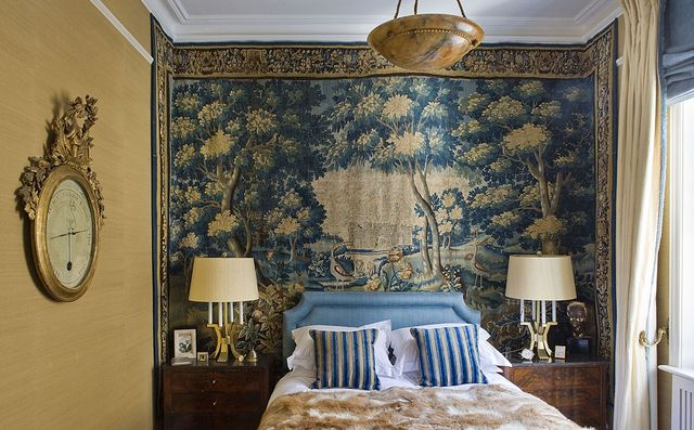 The tapestry in the master bedroom is 17th-century Flemish; the linens are by D. Porthault, and the throw pillows are of a Georges Le Manach cotton from ...