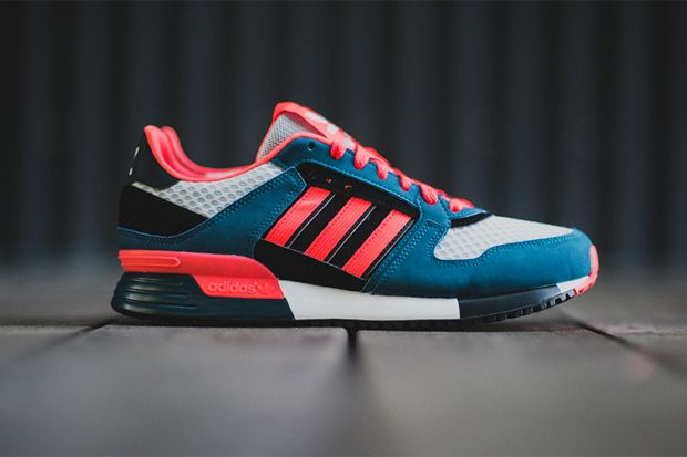 ca7d0529de6ca adidas Originals presents a bold new colorway for the ZX 630 silhouette.  Appearing with a base of deep blue suede and grey mesh