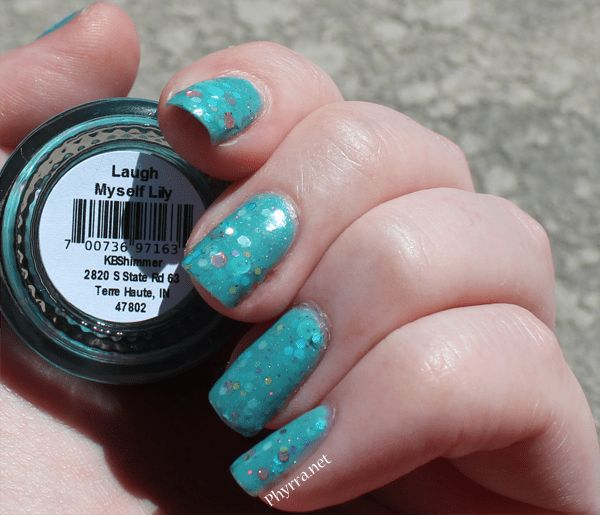 fb49e99612 This is KBShimmer Laugh Myself Lily Nail Polish. to me, it's a gorgeous  aquamarine crelly with large glitter hexes and tiny holographic micro  glitter.