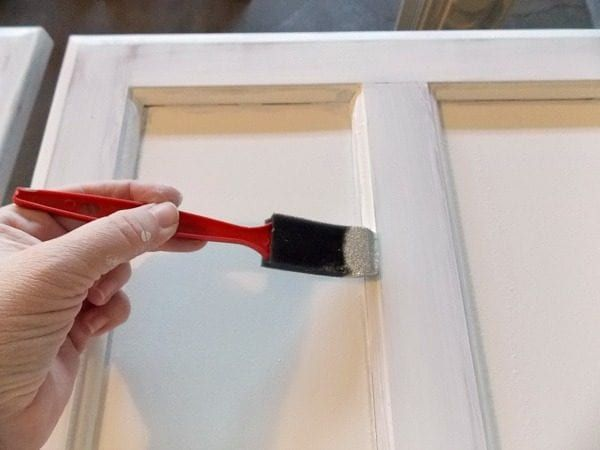How to paint cabinet doors remodelaholic bloglovin for Caulking around kitchen cabinets