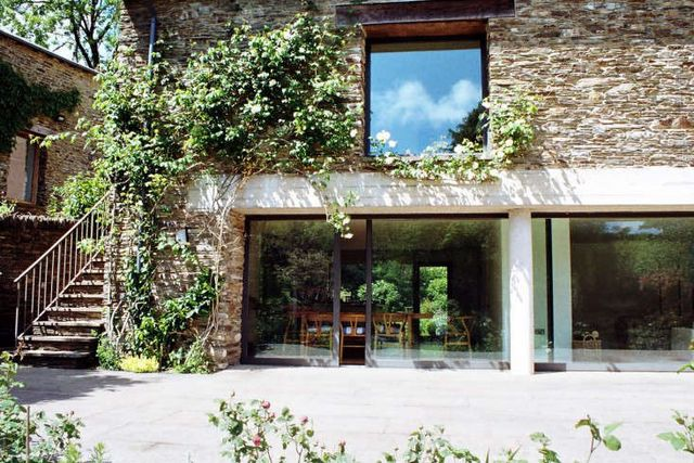 Above A Modern Glass And Stone Retreat Within Walled Garden In Devonshire