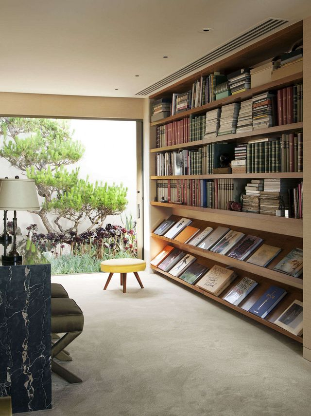 Above In The Beverly Hills Home Of Fashion Photographer Steven Meisel Low Wide Display Shelves Hold Favorite Design Books Photograph By Roger Davies