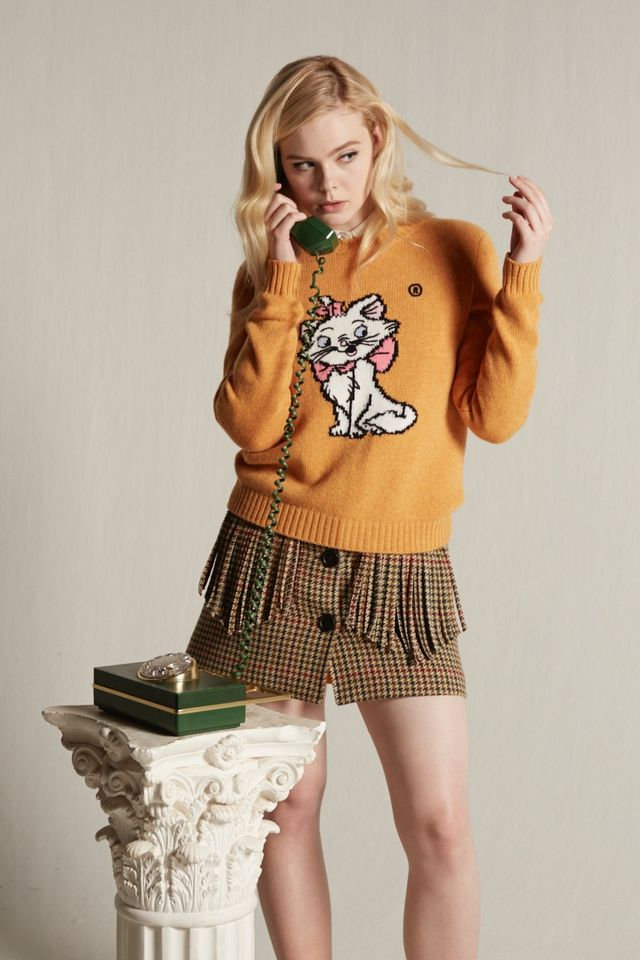 9cfd9afdf2 Elle Fanning Models Miu Miu's Adorable Cat Sweaters | Fashion Gone ...