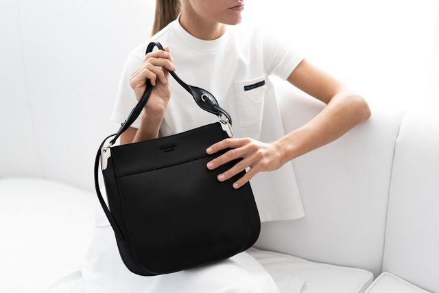 Enter the new Prada Margit line. This bag looks compact (and it is) but  it s also deceivingly spacious ec4e7bc7aaffb