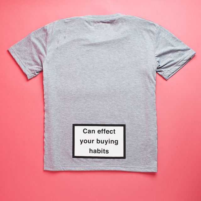 """040903af9 The back of the shirt has the real statement piece, though. This """"Can  effect your buying habits"""" graphic looks like a warning label you'd find on  a ..."""