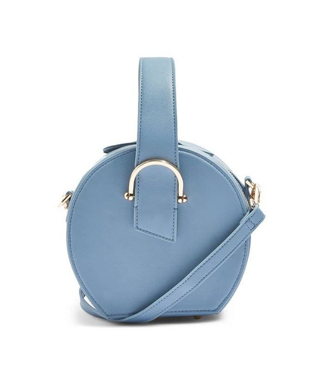 f3fba2c309a3 See Karen Blanchard s snake-print Topshop bag up top  Nordstrom s got it in  baby blue