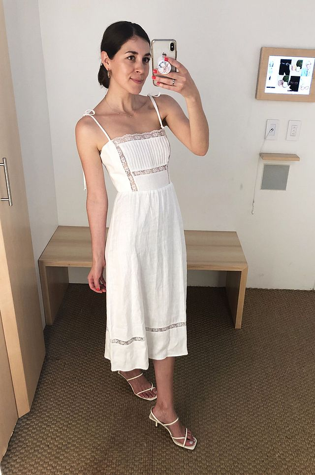 242309ae4c1 An effortless white dress is high on my wish list for weekend summer  getaways. I m obsessed with this lace and linen midi dress from Reformation.