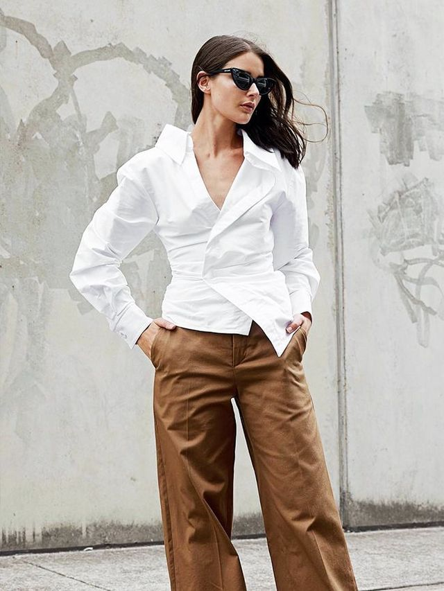 6245125e28b Sara Crampton of Harper and Harley also believes in the power of the wrap  shirt, only this time she proves just how good they look with a pair of  wide-leg ...