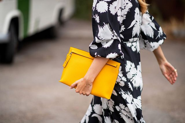 5427045279f7 I last remember seeing this oversized-clutch this trend in the early 2000s,  but when Prada, Givenchy, Chanel, and Céline put it on their runways this  year, ...