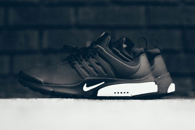 cheap for discount d47eb cbbf0 The Nike Air Presto Low Utility Drops in a Classic Black and White Colorway