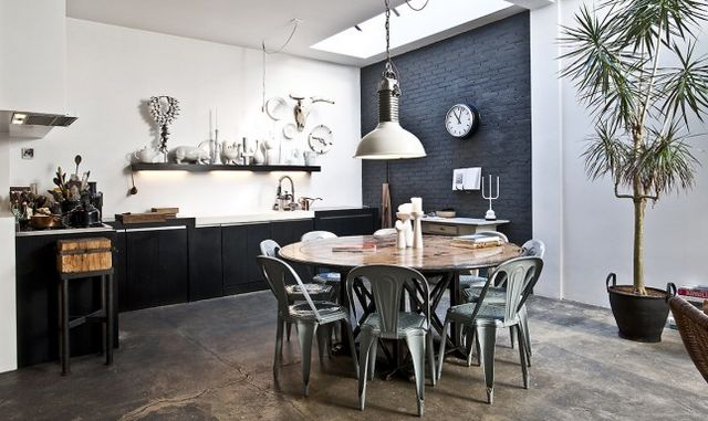 Dark parquet or raw concrete flooring brick walls vintage decoration ethnic details give a welcoming atmosphere typical of eclectic decoration
