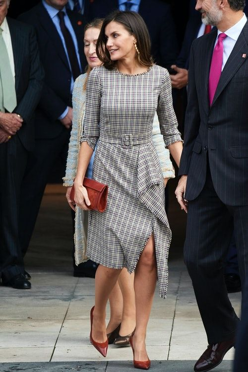 e846a630f096 ... a welcomed change of pace for the Queen, who typically opts for simple,  sleek silhouettes, but because it channeled Markle in the best, most subtle  way.